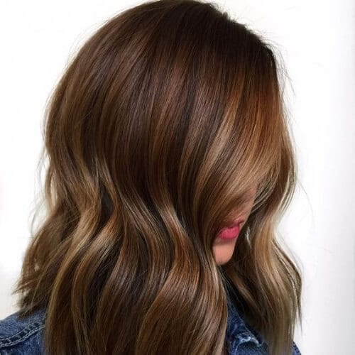 Flattering Streaks dark hair with caramel highlights