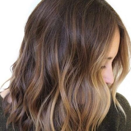 lighter in front dark hair with caramel highlights