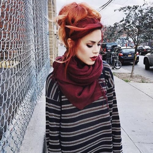 volumized high bun red ombre hair