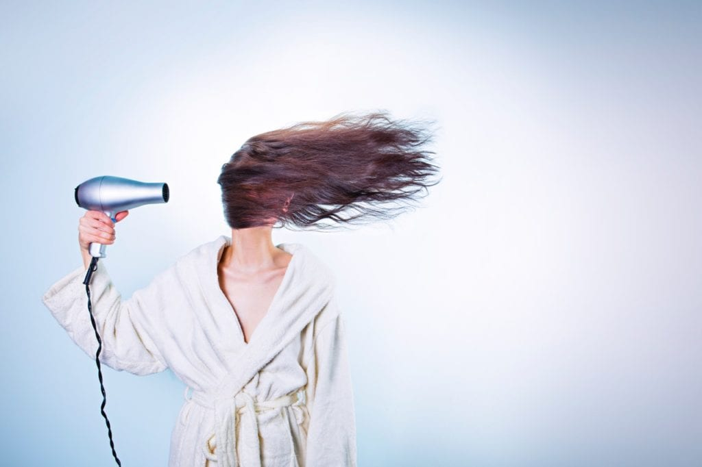 woman using the best hair dryer for curly hair