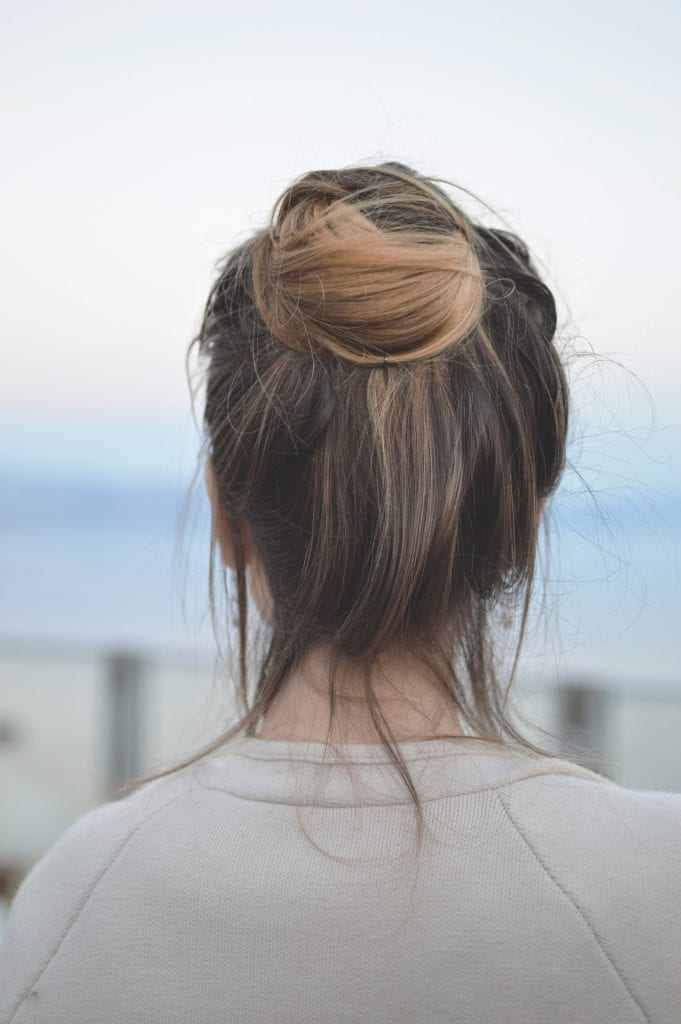 Women with half up bun hairstyle