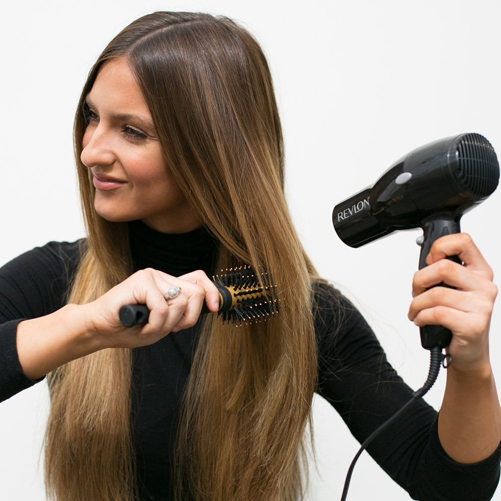 woman using one of the best blow dryer models